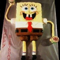 Spongebob  Spongebob cake for a 1st birthday. Hand carved, covered in MMF, shoes, patties are rice crispie treats. Also see the smash cake of...