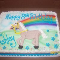 Horse   airbrushed rainbow with horse piped on with buttercream.
