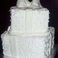 Square Cakes   buttercream base with fondant bow and accents. dots and swirls.