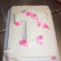 Baptism Cake 1/2 sheet cake with cross and fondant flowers.writting on scroll in bottom left corner.