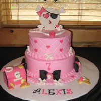 Lexies 7Th Birthday 10 in cake & 8 in. Iced in BC with fondant/gumpaste decorations. The theme is girly skull, colors went with the party supplies. The...