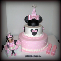 Shellbie's Minnie Mouse  10in. white cake & 6in. yellow cake with Butavan flavoring. Iced in BC with fondant decorations. The topper half of a styrofoam ball...