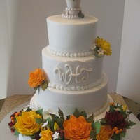 Hensley Fall Wedding Cake I made this cake for my niece's wedding this weekend. Sizes are 12in,10in.,8in.,6in. The topper is a vase made from sugar with...