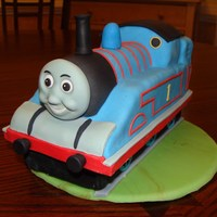 Thomas Topper I made for my youngest son's 4th birthday. Rice krispies covered in fondant.