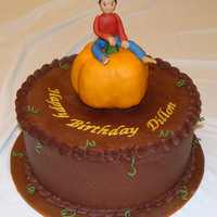 Boy On A Pumpkin All chocolate cake I made for one of my son's friends whose birthday was a day before Halloween. First time I used rice krispies (for...