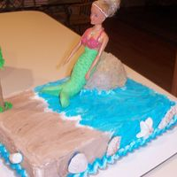 Mermaid Cake   Mermaid birthday cake - buttercream with fondant accents. The seashells are made of fondant, as is the mermaid fin.