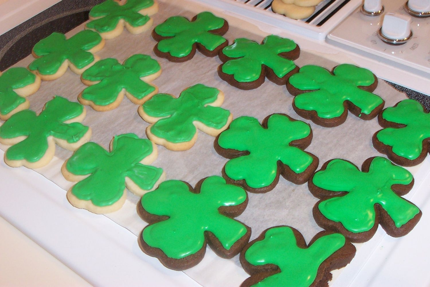St. Patty's Day Chocolate & Sugar Shamrock Cookies  Some No Fail Sugar Cookies and Rolled Chocolate Cookies with royal icing. I just took a quick shot of them as they were drying, waiting to...