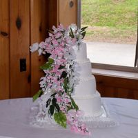 Tara's Cake This is a four tiered stacked cake iced in BC with silk flowers