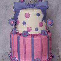 Girls' Birthday Cake This is a two-tiered French Vanilla cake made for a double birthday party for two girls. The lady said I could make whatever I wanted, just...
