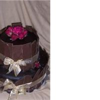 Chocolate Cake This is a Black Forest Cake with Raspberry Mousse filling & Chocolate Fudge Icing. Decorated with chocolate shards, ribbon & real...