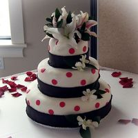 Black, White & Pink Polka Dots This is a cake I made for my sister's friend's wedding. It was supposed to be plain, but I since I am kinda out of practice...
