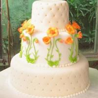 Blossoming a simple cake in fondant, and gumpaste roses, with a crosshatch pattern of piercings with edible beads at the junctions