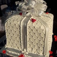 Gift Box a three flavored (mocha, chocolate, butter) wedding cake covered in vanilla flavored fondant, decorated with royal icing and real ribbons(...