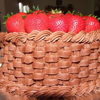 Basket Of Stawberries Cake  I just LOVE doing the basketweave that I learned last week at the end of Course II. I wanted to practice yet again so I made a cake to...
