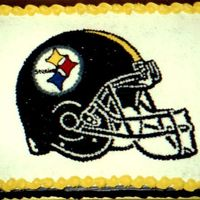 Football Helmet I made this for my Sister Inlaw and Bother Inlaw. It was the Grooms cake at their wedding. He is a big fan and didn't want to cut it....