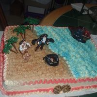 Pirates Of The Carribean Here is typical Pirates of the carribean cake with characters. The sand is ground cake