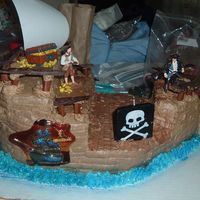 Pirate Ship Pirate ship cake for my son's 8th b-day. Buttercream icing dyed brown. Tootsie rolls holding the rails and the rails are milk...