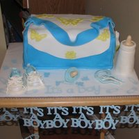 Diaper Bag fondant covered cake, other items made from gumpaste