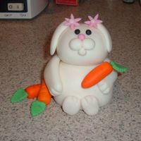 Bunny Luvs Carrots Fondant and GP sculpted bunny with smallest daisy cutout for hairpins, holding fondant carrots.