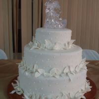 In White   3 Tier Wedding cake, Covered in fondant and gumpatse leaves.