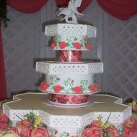 Garden Terraces  This was a cake design taken from a Wilton wedding cake book. The bride was doing a garden theme, with pale yellow, and coral colors. They...