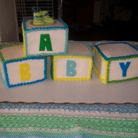 Baby Block Cake   Baby block cake is made from 4- 6 inch square cakes and are triple layered for a block shape. The cake is all in buttercream icing.