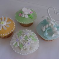 Cupcakes With Fondant Toppers a grouping we did for a bride to select from who wanted a spring effect