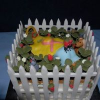 Strawberry Patch Cake Old lady crawling through her strawberry patch, strawberries, leaves, dog, bunny, ants, worm and fence made from gum paste. Hat made from...