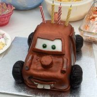 Tow Mater This was for my nephew's 4th birthday party. Its chocolate cake with chocolate IMBC, covered in MMF and brushed with copper lustre...