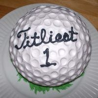Golf Ball Father's day cake for my father in law who loves golfing. Used the sports ball pan and the end of my candy thermometer to make the...