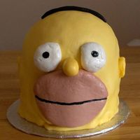 D'oh! Homer Simpson cake, Killer chocolate cake with Lindt chocolate IMBC. Covered in MMF. Its one 6 x 3 inch and 6 x 2 inch, topped with half a...
