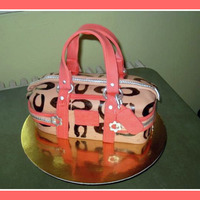 "Alicia's Coach Bag this cake was a headache at start, but I think I did a good job ""saving"" it. The bday girl LOVED it!"