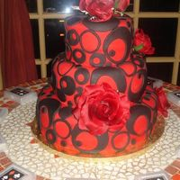 Red/black Circles All Fondant, Red Velvet Cake...I made this for my own Bday Party.