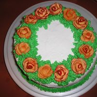 Roses  this is one of the first cakes i made. it was for a birthday. now i cant remember wha tkind of roses i was trying to imitate... but i...