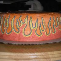 Flames this is another one of my first cakes. i freehanded the flames on to it with buttercream and then filled them in using the same.