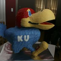3D Jayhawk Being a K- state fan, this was a challenge... He has a wood frame, covered with rice krispies on the bottom half and cake, obviously, on...