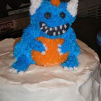 Little Monster this was for my youngest son's first brithday. it is a small bear cake mold that i starred to to make into the shape it is in now.