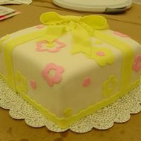 Present Cake With Yellow Bow Did this for a Wilton course 3 class. Didn't plan out my placement too well...just kind of slapped everything on as we were running...