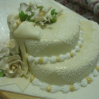 Shahril's Wedding Cake   heart shaped fondant wedding cake with theme of gold. got the idea from cakecentral and luv it