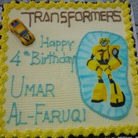 Transformers   Chocolate cake and butter cream .Unable to get the edible print of the robot and had to draw it on a piece of fondant myself.