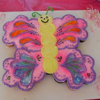 Butterfly Cupcake Cake I made this cake for my daughter's first birthday. It was outside so having cupcakes was much easier to do, but I still wanted it to...