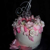Pink Rhinestone Cake Three layer lemon cake with cheesecake filling. Decorated with pink roses and rhinestones.