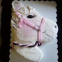 Horse Cake Carved cake iced in buttercream with satin ice fondant and painted details