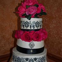 Rachael & Kiel's Couples Shower Cake Decorated with buttercream, edible damask transfers and fresh roses.