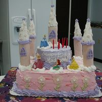 Princess Cake This cake was freakin'huge! This is a Disney Princess cake for my neice's 6th birthday. The towers are papertowel and toiletpaper...