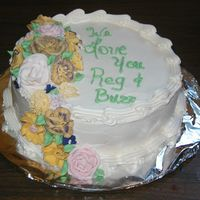 Pastor Appreciation Sour Cream cake with half butter, half Crisco buttercream, filled with vanilla pastrycream. Flowers are royal icing
