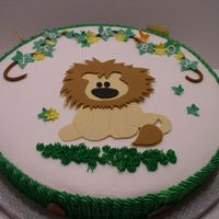 Lion Baby Shower Cake White cake with BC. Gumpaste jungle animals on side of cake as well.