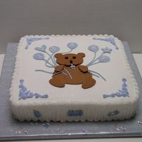 Little Brown Bear   White cake with bc. Decorations made from a cutout pattern on top of cake. Inspired from a past Cake Craft & Decoration magazine.
