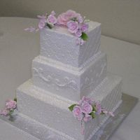 Square Wedding Cake   White cake with buttercream.