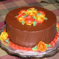 Fall Flowers Cake This is a chocolate cake with chocolate buttercream frosting. The roses and decorations are vanilla buttercream. In real life the flowers...
